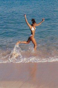Woman Enjoying Life At The Beach