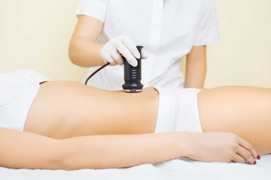Woman Lying Down Receiving A Cavitation Treatment